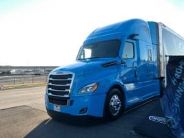 A Freightliner Cascadia equipped with the Stoneridge MirrorEye camera system waits to take a lap...