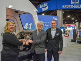 Equipment editor Jim Park presents the award to Rebecca Carter, Product Manager; and John Kemer,...