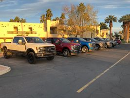 A lineup of brand-new 2020 Super Duty trucks await a day on the Arizona highways.