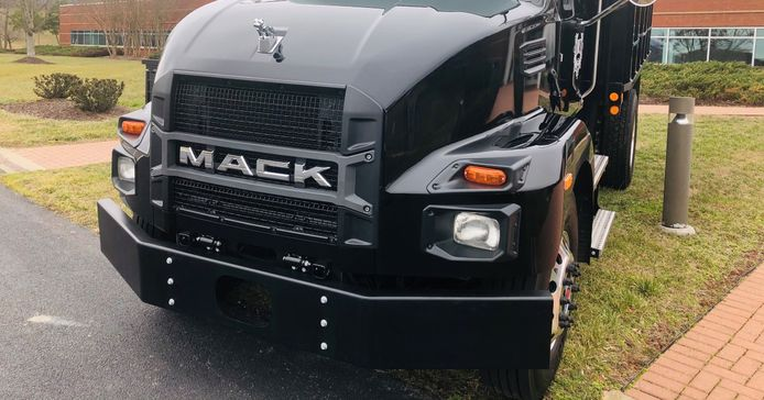 Unmistakably aMack Truck,new Class 6 and 7 MD Series models shareexterior design cues with...