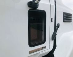 This MD Series cab is fitted with an extra window on the passenger side to improve outward...