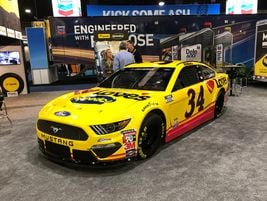 A Mustang GT race car adorns the Love's Truck Stops booth on the show floor at the 2020 TMC...