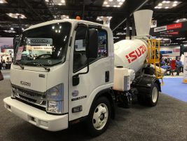 Isuzu NPR with a concrete mixer chassis.