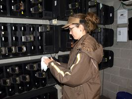A UPS driver disinfects Delivery Information Acquisition Devices, or DIADs.