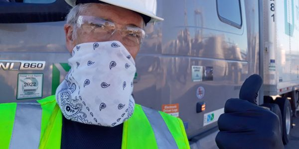 Truck driver Mark Sain uses a bandana as a face covering to help slow the spread of COVID-19.
