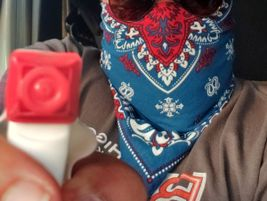 A Brent Higgins Trucking driver armed with bandana and sanitizing spray.