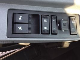 Door locks, morror adjustment and power window controls are on the driver's door sill. Super...