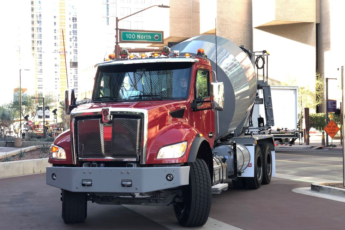 A light Class 8 Kenworth T480 with a McNeilus mixer makes a 180-degree turn before starting a...