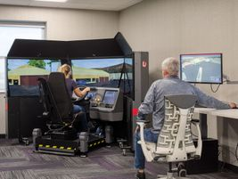 Prime's new amenities building includes a state-of-the-art truck driving simulator for students...