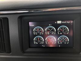 A new brilliantly lit series of gauges can be infinitely arranged by the driver into the middle...