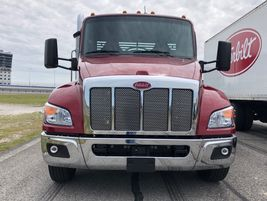 A new, sleeker, front end enhances the overall aerodynamic efficiency of the new Peterbilt...