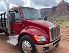 A Peterbilt Model 536 stake truck prepares to take a lap around the off road course in Gateway,...