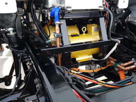 Space formerly occupied by the engine on the Model 220 EV now houses electric motors for the air...