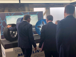 Michelin Uptis airless tire prototype (left) getting lots of attention and explanation at tire...