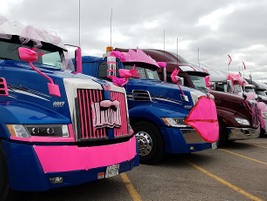 Drivers participating in the Trucking for a Cure Convoy decorate their trucks eye-catching...