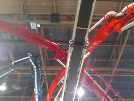 Putzmeister pumper booms and a belt conveyor reach toward the ceiling of the Las Vegas...