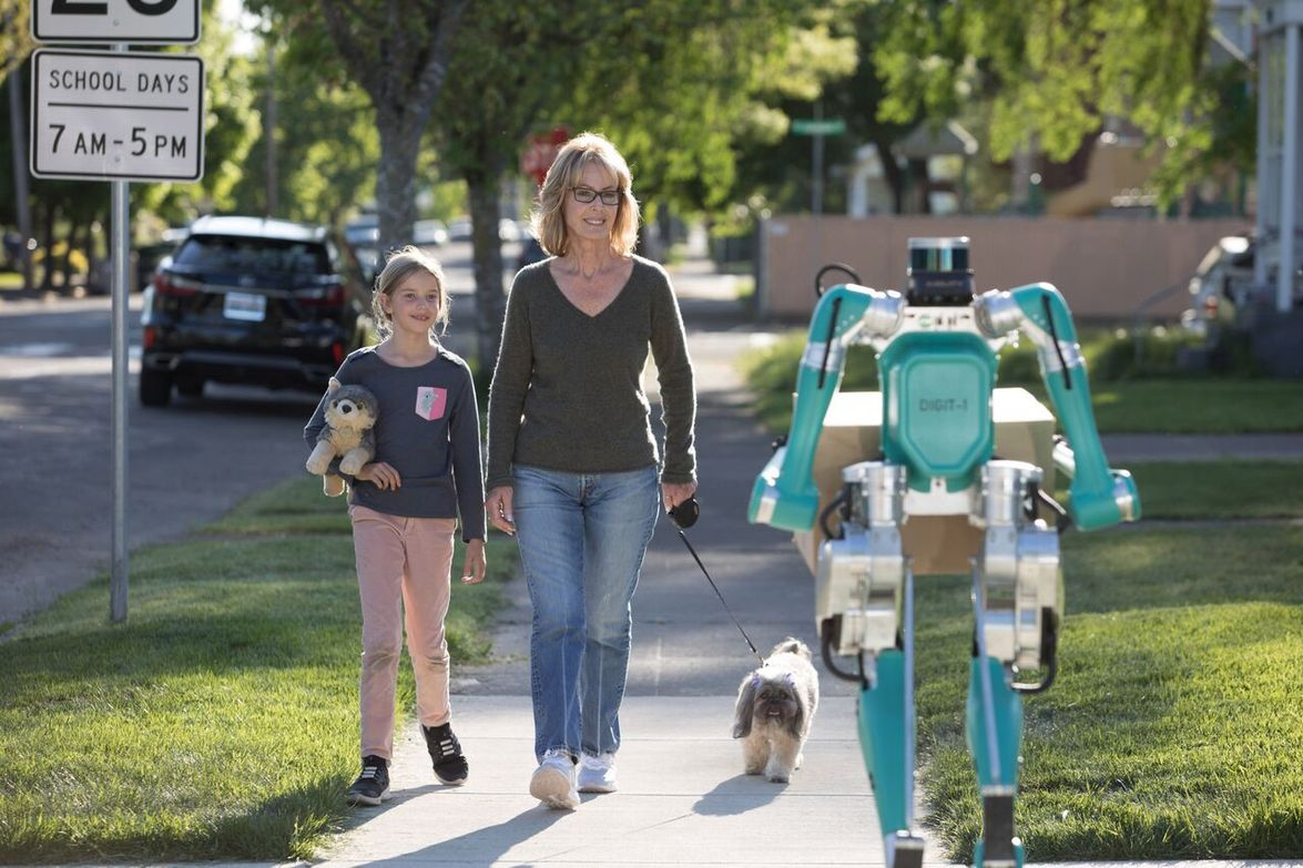 Ford's Digit delivery robot is designed to not only approximate the look of a human, but to walk...