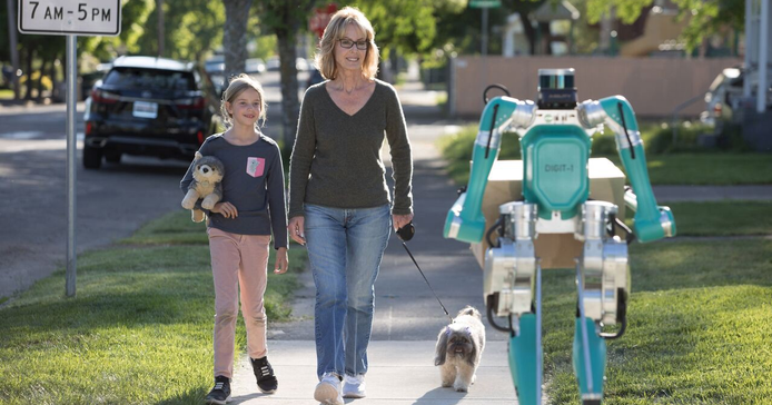 Ford's Digit delivery robot is designedto not only approximate the look of a human, but to walk...