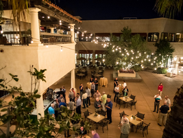 At night, attendees mingled in an outdoor area at the resort.