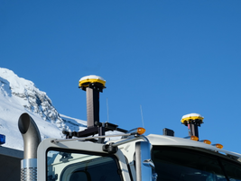 These devices are GPS satellite receivers. The system, from MTS Systems, helps plow drivers...