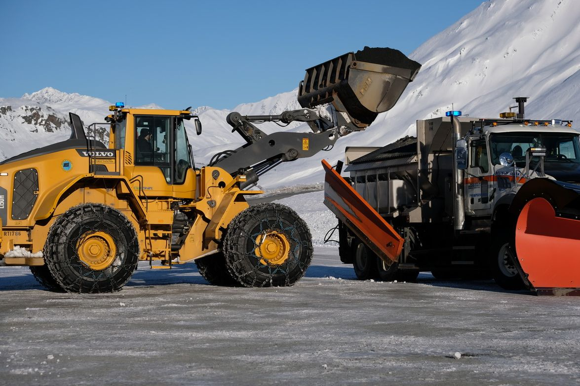 Fully loaded with sand and brine and all the plowing gear, the Mack Granite snowplow weighs a...