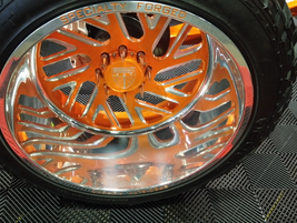Cool rims with vibrant colors on the MATS show floor.