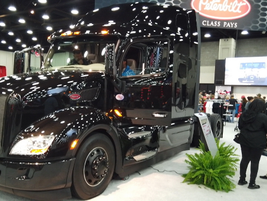 Peterbilt had its new Model 579 on the floor with the Blackout Exterior Package. Judging by the...