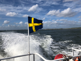 The Swedish flag flies proudly astern on a dinner outing from the Volvo Trucks Headquarters in...
