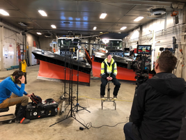 The Mack video crew is set up in the DOT garage to interview snow plow driver, Moana Bradshaw.
