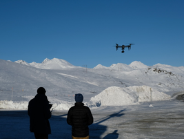 Flying the camera drone is a four-handed operation. One operator keeps the drone where it's...