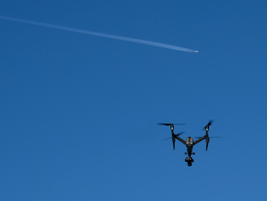 While camera drone hovers over the truck, an international flight soars overhead. These flights...