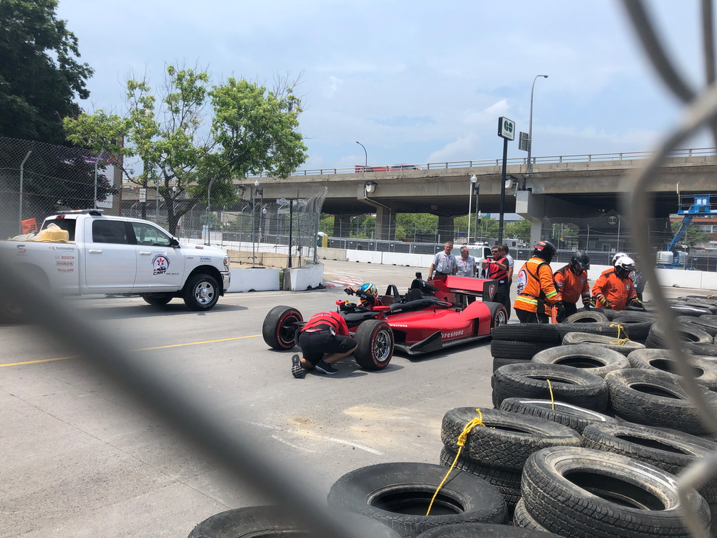 One of the cars came into the final turn a bit hot and ran into a pile of tires. No injuries...
