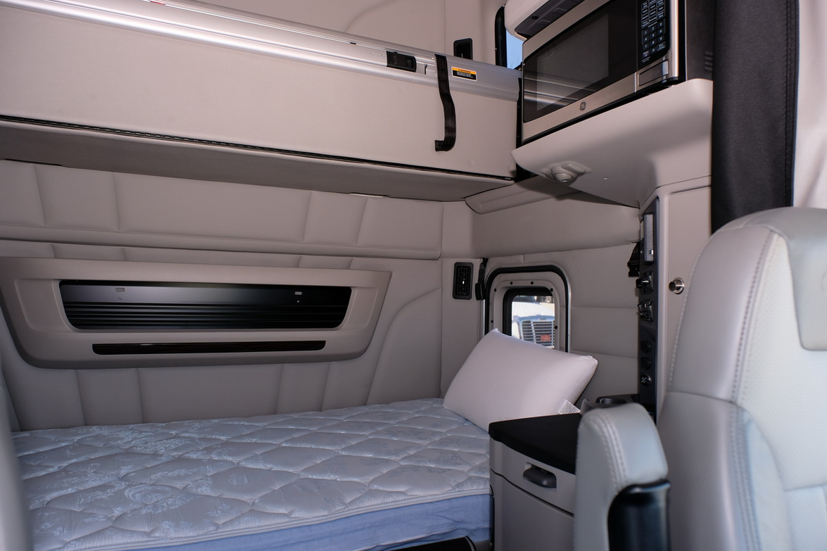 The lower bunk of the UltraLoft sleeper features a full-size single bed with a pocket coil...