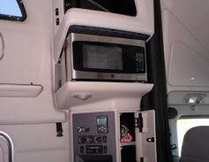 The driver's side cabinet features a pull-out desk, the sleeper compartment HVAC and audio...