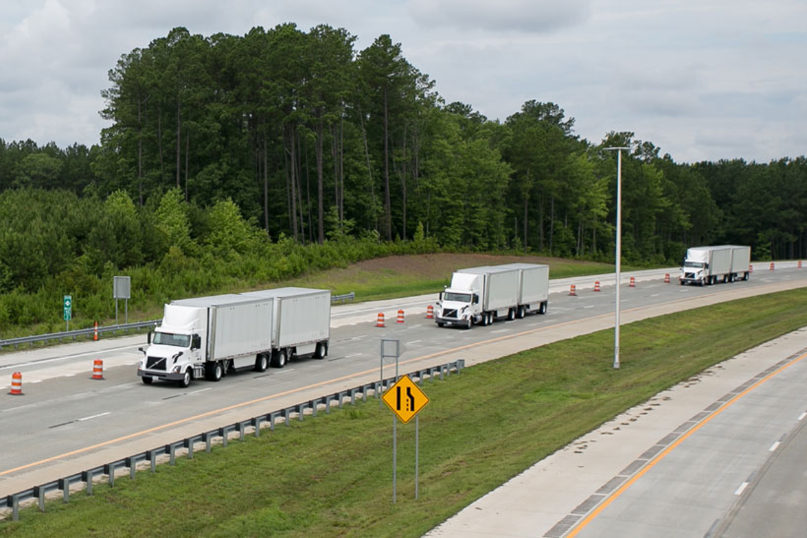 The three test trucks in platoon formation on North Carolina's N.C. 540, called the Triangle...