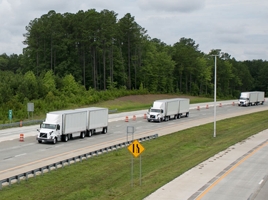 The three test trucks in platoon formation on North Carolina'sN.C. 540, called the Triangle...
