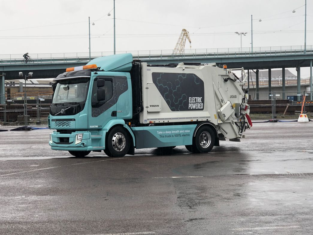 Volvo's new FE Electric, all-electric refuse truck, runs through a test course set up in the...
