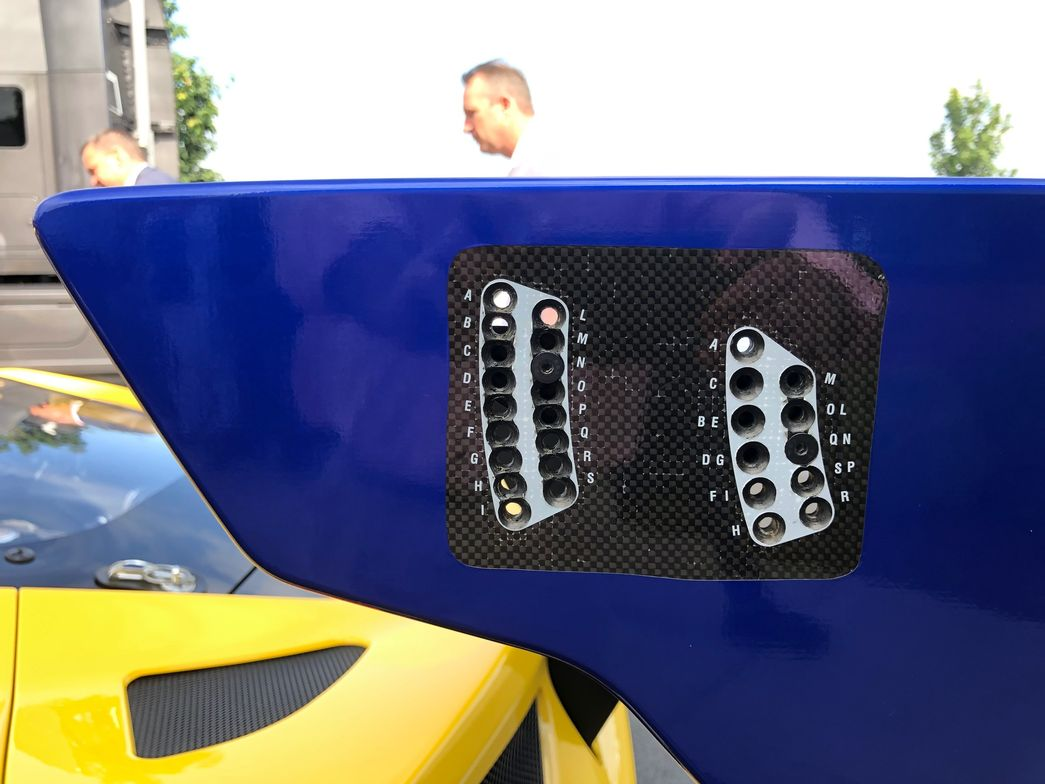 This closeup of the rear spoiler on one of the GT cars shows the wide range of adjustments...