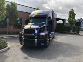 A Mack Anthem decked out in Vital Speed Racing livery on display at TEC Equipment in Portland,...