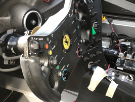 A Ferrari steering wheel features a whole host of control functions not found on normal...