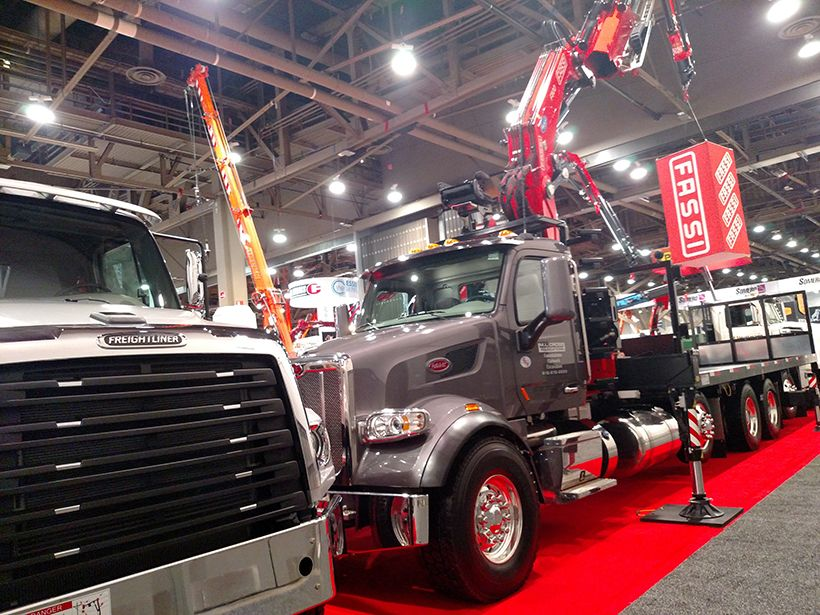 Competitive truck brands coexist in equipment suppliers' booths, as with this maker of truck...