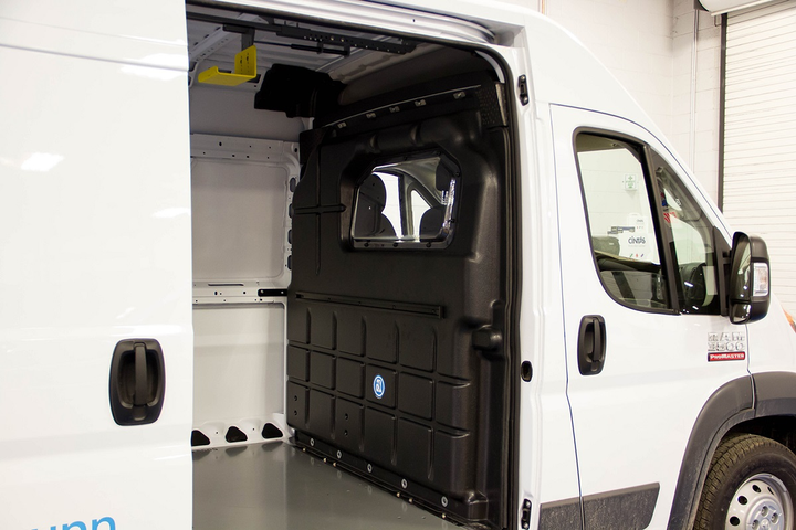 The composite partition with a window from Adrian Steel is designed to keep the cab area quiet and provides better leg room and climate control.  - Photo via Adrian Steel