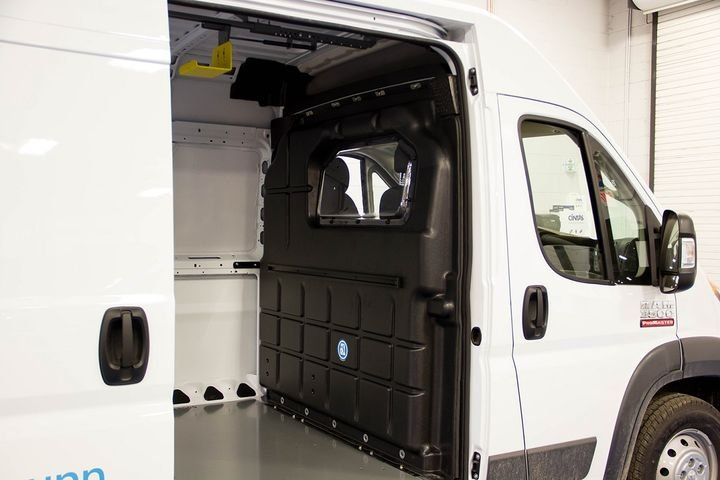 The composite partition with a window from Adrian Steel is designed to keep the cab area quiet and provides better leg room and climate control.
