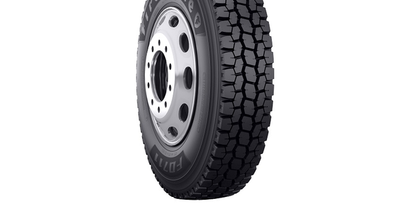 The Firestone FD711 drive tire is designed for durability and longevity in high-scrub and...