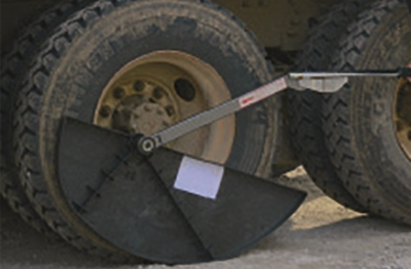 The Torque Fin is a torque wrench-stabilizing accessory for commercial tire servicing.  - Photo via AME
