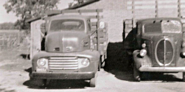 Ralph Moyle's first truck, on the right, was a 1940 Ford. Next to it on the left is the third...