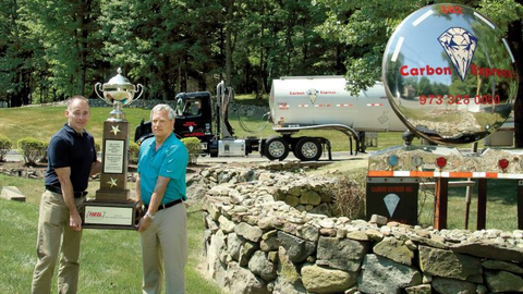 Controller Sean McAllister and Director of Safety John Bowlby hold the National Tank Truck...