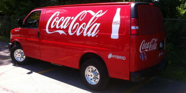 Coca-Cola purchased 100 gasoline-electric hybrid Chevrolet Express delivery vans that were...