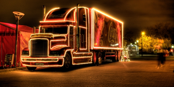 Photo of Coca-Cola truck lit up in the holiday spirit courtesy of Wiki Commons: Stengaard