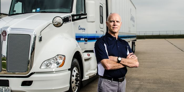 Albert Johnson, Con-way Truckload's vice preisent of human resources, works from the company's...